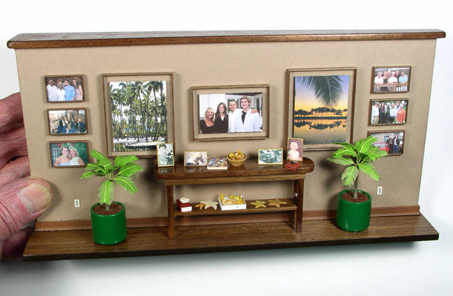Picture wall with lots of family photos and mementos